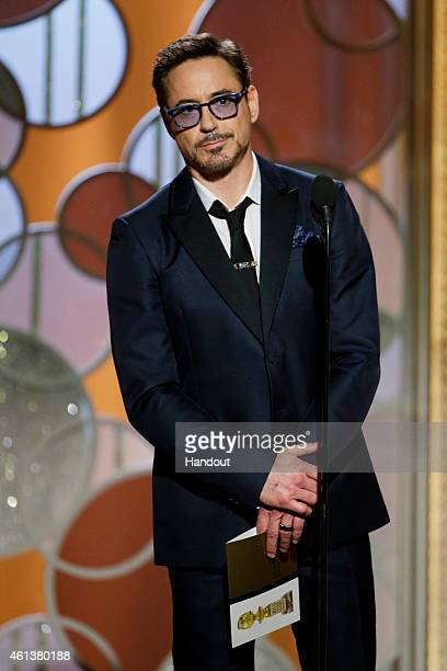 In this handout photo provided by NBCUniversal Presenter Robert Downey Jr speaks onstage during the 72nd Annual Golden Globe Awards at The Beverly...