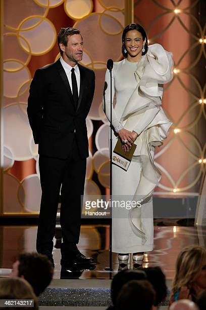 In this handout photo provided by NBCUniversal Presenters Aaron Eckhart and Paula Patton speak onstage during the 71st Annual Golden Globe Award at...