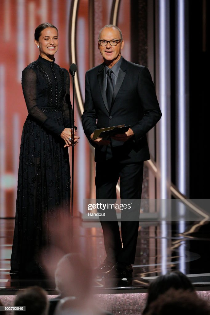 In this handout photo provided by NBCUniversal, Presenters Alicia Vikander and Michael Keaton speak onstage during the 75th Annual Golden Globe Awards at The Beverly Hilton Hotel on January 7, 2018 in Beverly Hills, California.