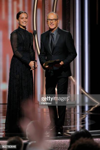 In this handout photo provided by NBCUniversal Presenters Alicia Vikander and Michael Keaton speak onstage during the 75th Annual Golden Globe Awards...