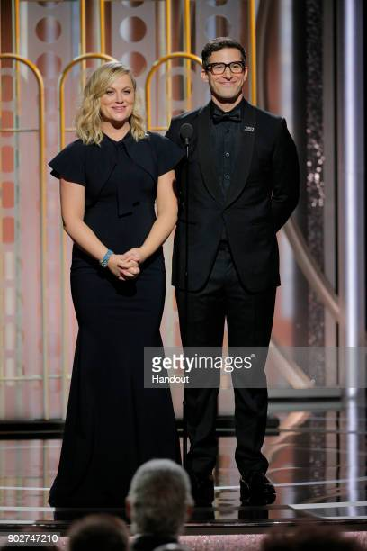 In this handout photo provided by NBCUniversal Presenters Amy Poelher and Andy Samberg onstage during the 75th Annual Golden Globe Awards at The...