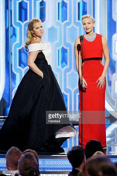 In this handout photo provided by NBCUniversal Presenters Amy Schumer and Jennifer Lawrence speak onstage during the 73rd Annual Golden Globe Awards...
