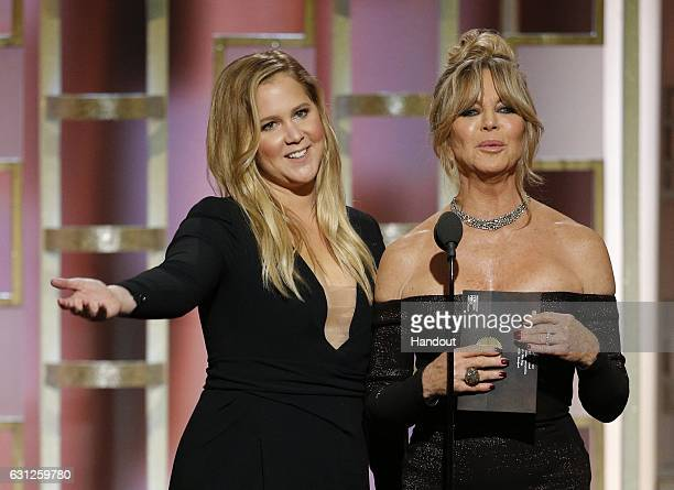 In this handout photo provided by NBCUniversal presenters Amy Schumer and Goldie Hawn onstage during the 74th Annual Golden Globe Awards at The...