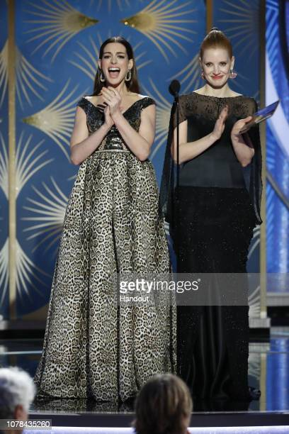 In this handout photo provided by NBCUniversal Presenters Anne Hathaway and Jessica Chastain speak onstage during the 76th Annual Golden Globe Awards...