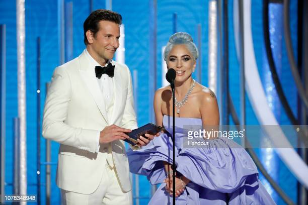 In this handout photo provided by NBCUniversal, Presenters Bradley Cooper and Lady Gaga speak onstage during the 76th Annual Golden Globe Awards at...