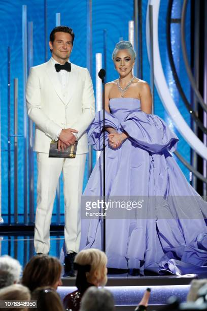 In this handout photo provided by NBCUniversal Presenters Bradley Cooper and Lady Gaga speak onstage during the 76th Annual Golden Globe Awards at...