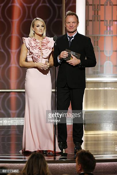 In this handout photo provided by NBCUniversal presenters Carrie Underwood and Sting onstage during the 74th Annual Golden Globe Awards at The...