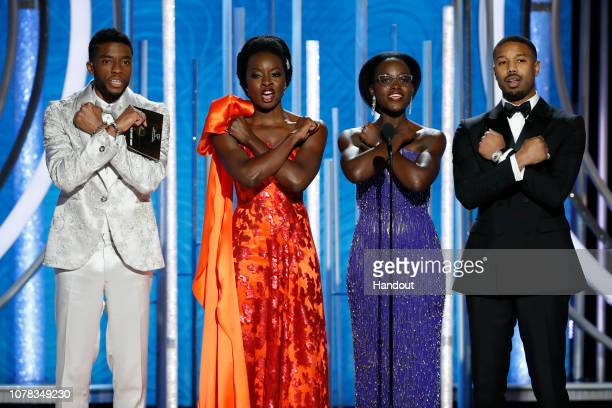 In this handout photo provided by NBCUniversal, Presenters Chadwick Boseman, Danai Gurira, Lupita Nyong'o and Michael B. Jordan speak onstage during...