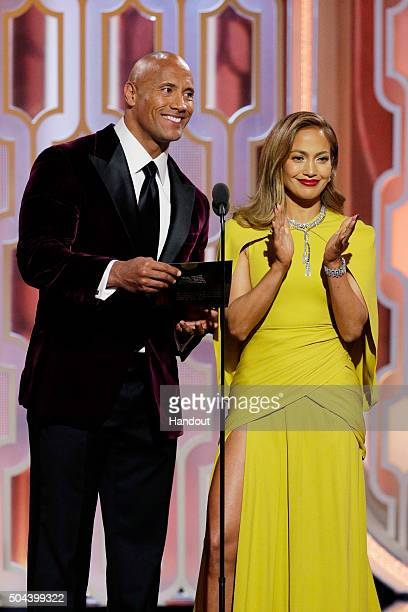 In this handout photo provided by NBCUniversal Presenters Dwayne Johnson and Jennifer Lopez speak onstage during the 73rd Annual Golden Globe Awards...