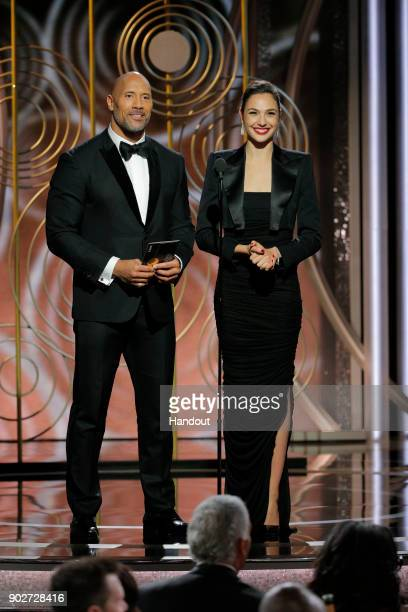 In this handout photo provided by NBCUniversal Presenters Dwayne Johnson and Gal Gadot speak onstage during the 75th Annual Golden Globe Awards at...