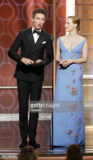 In this handout photo provided by NBCUniversal presenters Eddie Redmayne and Jessica Chastain onstage during the 74th Annual Golden Globe Awards at...