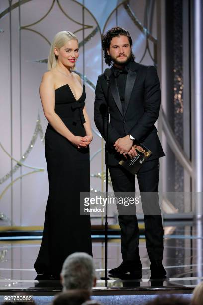 In this handout photo provided by NBCUniversal Presenters Emilia Clarke and Kit Harrington speak onstage during the 75th Annual Golden Globe Awards...