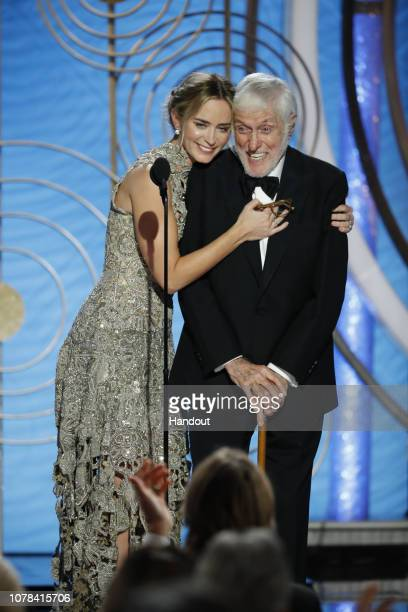 In this handout photo provided by NBCUniversal Presenters Emily Blunt and Dick Van Dyke speak onstage during the 76th Annual Golden Globe Awards at...
