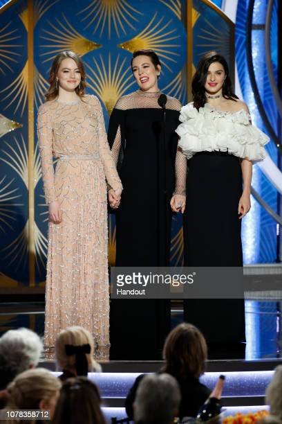 In this handout photo provided by NBCUniversal Presenters Emma Stone Olivia Colman Rachel Weisz speak onstage during the 76th Annual Golden Globe...