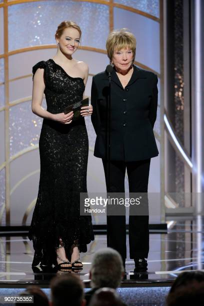 In this handout photo provided by NBCUniversal Presenters Emma Stone and Shirley MacLaine speak onstage during the 75th Annual Golden Globe Awards at...