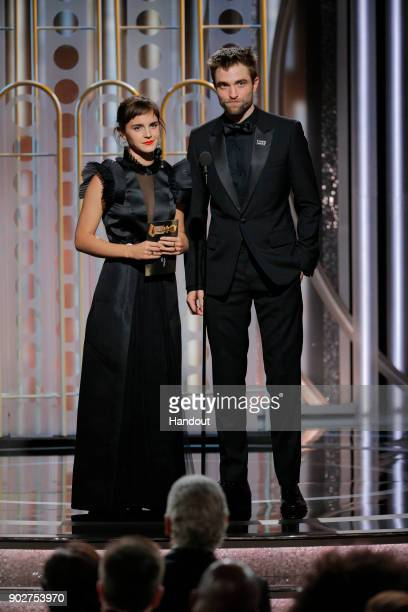 In this handout photo provided by NBCUniversal Presenters Emma Watson and Robert Pattinson speaks onstage during the 75th Annual Golden Globe Awards...