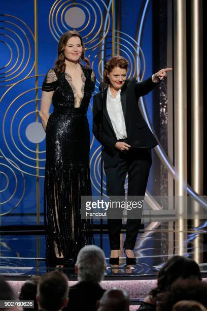 In this handout photo provided by NBCUniversal Presenters Geena Davis and Susan Sarandon onstage during the 75th Annual Golden Globe Awards at The...