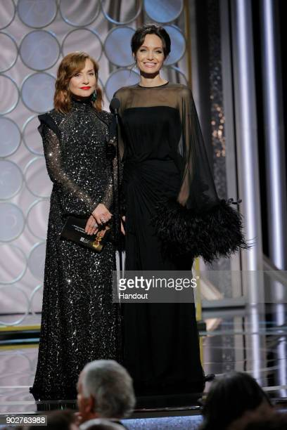In this handout photo provided by NBCUniversal Presenters Isabelle Huppert and Angelina Jolie speak onstage during the 75th Annual Golden Globe...