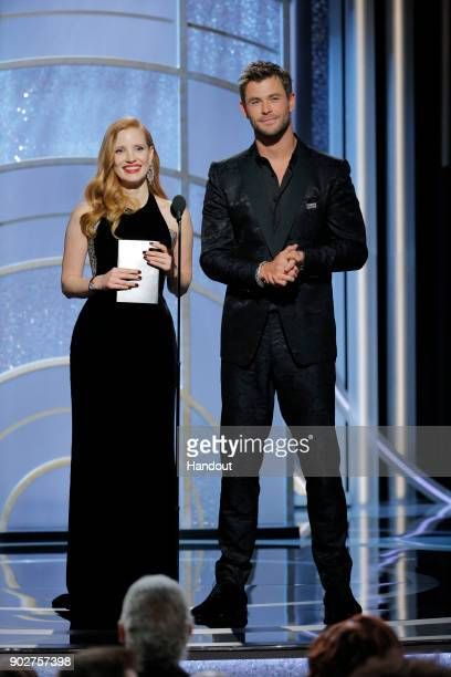 In this handout photo provided by NBCUniversal Presenters Jessica Chastain and Chris Hemsworth speak onstage during the 75th Annual Golden Globe...