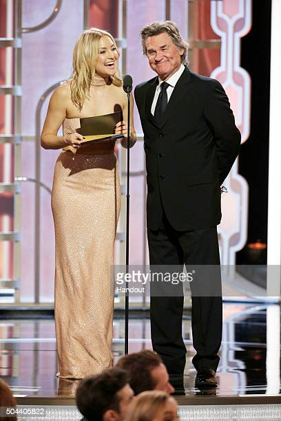 In this handout photo provided by NBCUniversal Presenters Kate Hudson and Kurt Russell speak onstage during the 73rd Annual Golden Globe Awards at...