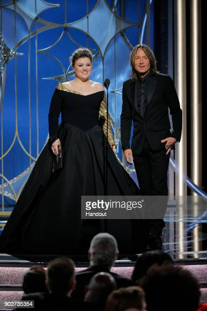 In this handout photo provided by NBCUniversal Presenters Kelly Clarkson and Keith Urban speak onstage during the 75th Annual Golden Globe Awards at...