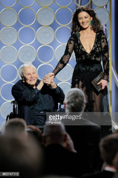 In this handout photo provided by NBCUniversal, Presenters Kirk Douglas and Catherine Zeta Jones speak onstage during the 75th Annual Golden Globe...