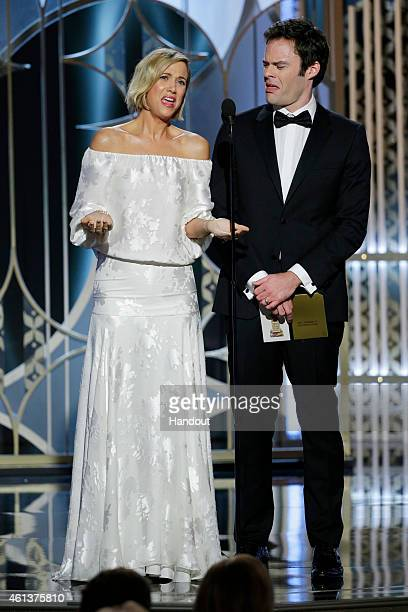 In this handout photo provided by NBCUniversal Presenters Kristen Wiig and Bill Hader speak onstage during the 72nd Annual Golden Globe Awards at The...