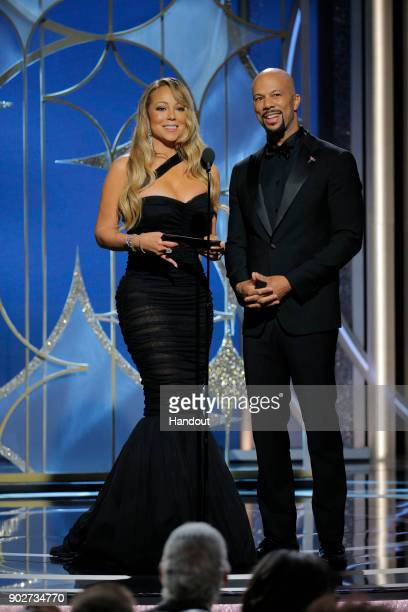 In this handout photo provided by NBCUniversal Presenters Mariah Carey and Common speak onstage during the 75th Annual Golden Globe Awards at The...