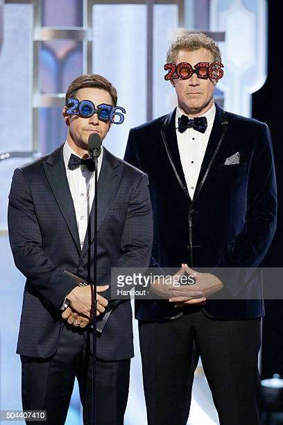 In this handout photo provided by NBCUniversal Presenters Mark Wahlberg and Will Ferrell speak onstage during the 73rd Annual Golden Globe Awards at...