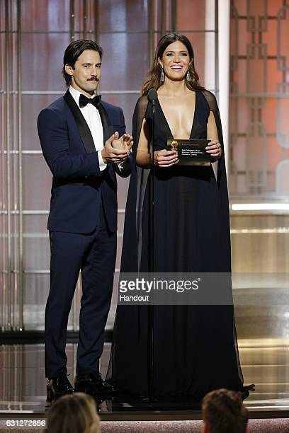 In this handout photo provided by NBCUniversal, presenters Milo Ventimiglia and Mandy Moore onstage during the 74th Annual Golden Globe Awards at The...