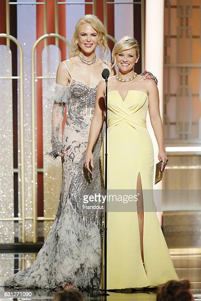 In this handout photo provided by NBCUniversal, presenters Nicole Kidman and Reese Witherspoon onstage during the 74th Annual Golden Globe Awards at...