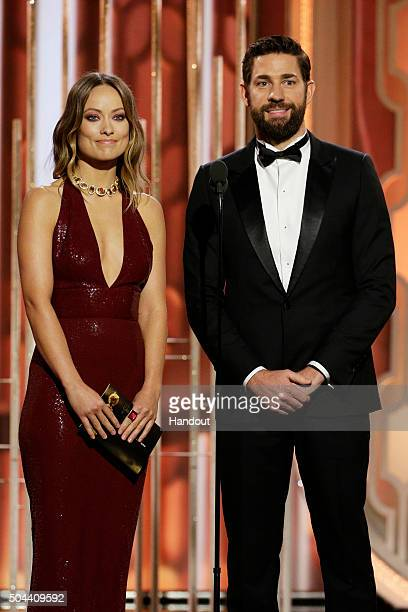 In this handout photo provided by NBCUniversal Presenters Olivia Wilde and John Krasinski onstage during the 73rd Annual Golden Globe Awards at The...