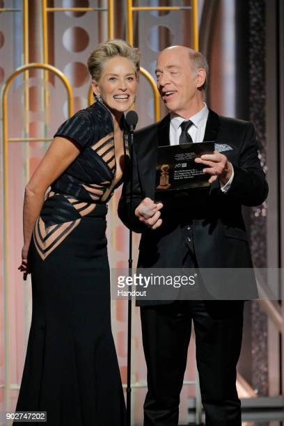 In this handout photo provided by NBCUniversal Presenters Sharon Stone and JK Simmons speak onstage during the 75th Annual Golden Globe Awards at The...