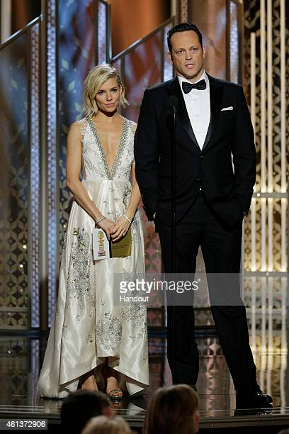 In this handout photo provided by NBCUniversal Presenters Sienna Miller and Vince Vaughn speak onstage during the 72nd Annual Golden Globe Awards at...