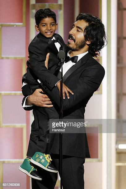 In this handout photo provided by NBCUniversal presenters Sunny Pawar and Dev Patel onstage during the 74th Annual Golden Globe Awards at The Beverly...