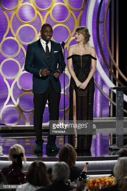In this handout photo provided by NBCUniversal Presenters Taylor Swift and Idris Elba speak onstage during the 76th Annual Golden Globe Awards at The...
