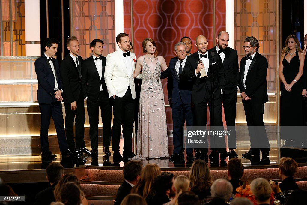 In this handout photo provided by NBCUniversal, producer Fred Berger and the cast and crew of 'La La Land' accept the award for Best Motion Picture - Musical or Comedy for 'La La Land' onstage during the 74th Annual Golden Globe Awards at The Beverly Hilton Hotel on January 8, 2017 in Beverly Hills, California.