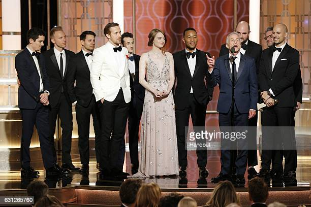 In this handout photo provided by NBCUniversal producer Marc Platt and the cast and crew of 'La La Land' accept the award for Best Motion Picture...