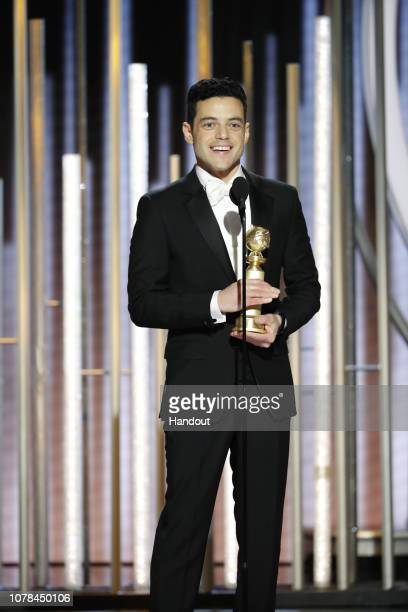 "In this handout photo provided by NBCUniversal Rami Malek from ""Bohemian Rhapsody"" accepts the Best Actor in a Motion Picture – Drama award onstage..."