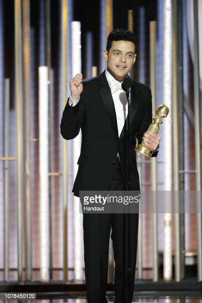 """In this handout photo provided by NBCUniversal Rami Malek from """"Bohemian Rhapsody"""" accepts the Best Actor in a Motion Picture – Drama award onstage..."""
