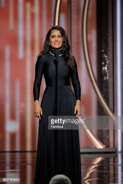 In this handout photo provided by NBCUniversal Salma Hayek Pinault speaks onstage during the 75th Annual Golden Globe Awards at The Beverly Hilton...