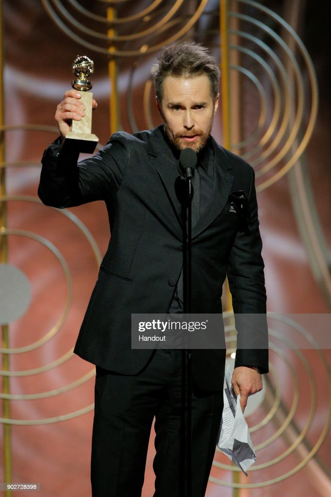 """In this handout photo provided by NBCUniversal, Sam Rockwell accepts the award for Best Performance by an Actor in a Supporting Role in a Motion Picture for """"Three Billboards Outside Ebbing, Missouri"""" during the 75th Annual Golden Globe Awards at The Beverly Hilton Hotel on January 7, 2018 in Beverly Hills, California."""