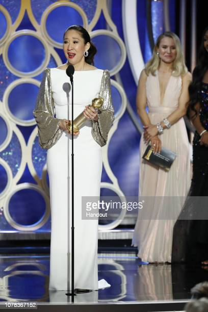 """In this handout photo provided by NBCUniversal Sandra Oh from """"Killing Eve"""" accept the Best Performance by an Actress in a Television Series – Drama..."""