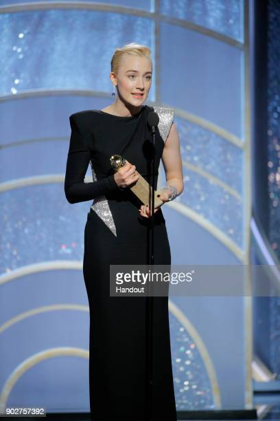 In this handout photo provided by NBCUniversal Saoirse Ronan accepts the award for Best Performance by an Actress in a Motion Picture – Musical or...