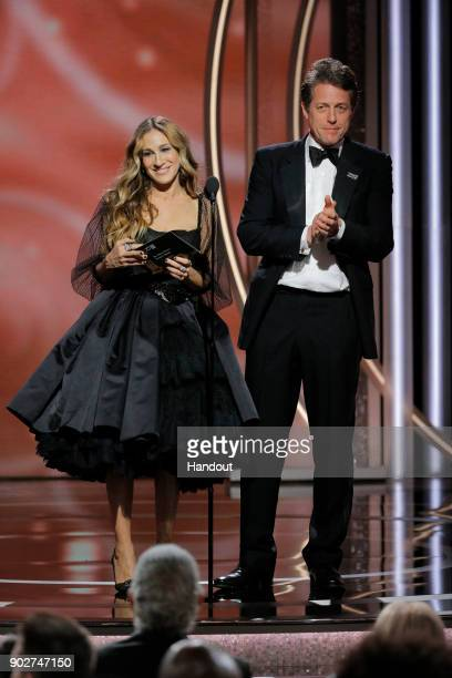 In this handout photo provided by NBCUniversal Sarah Jessica Parker and Hugh Grant speaks onstage during the 75th Annual Golden Globe Awards at The...