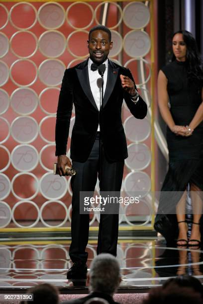 In this handout photo provided by NBCUniversal Sterling K Brown accepts the award for Best Performance by an Actor in a Television Series – Drama for...
