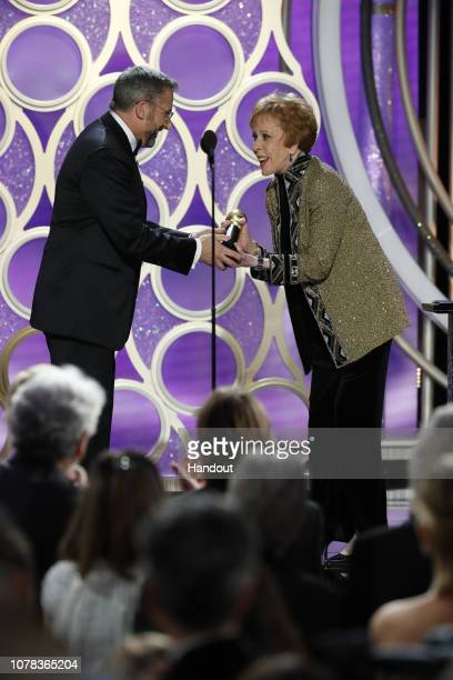In this handout photo provided by NBCUniversal Steve Carell presents Carol Burnett with the Carol Burnett TV Achievement Award onstage during the...