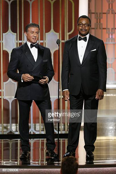 In this handout photo provided by NBCUniversal Sylvester Stallone and Carl Weathers who costarred in the 1977 Golden Globe Awardwinning film 'Rocky'...