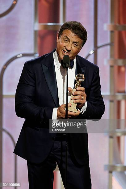 In this handout photo provided by NBCUniversal Sylvester Stallone accepts the award for Best Supporting Actor Motion Picture for 'Creed' onstage...