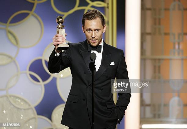 In this handout photo provided by NBCUniversal Tom Hiddleston accepts the award for Best Actor Limited Series or Motion Picture for TV for his role...